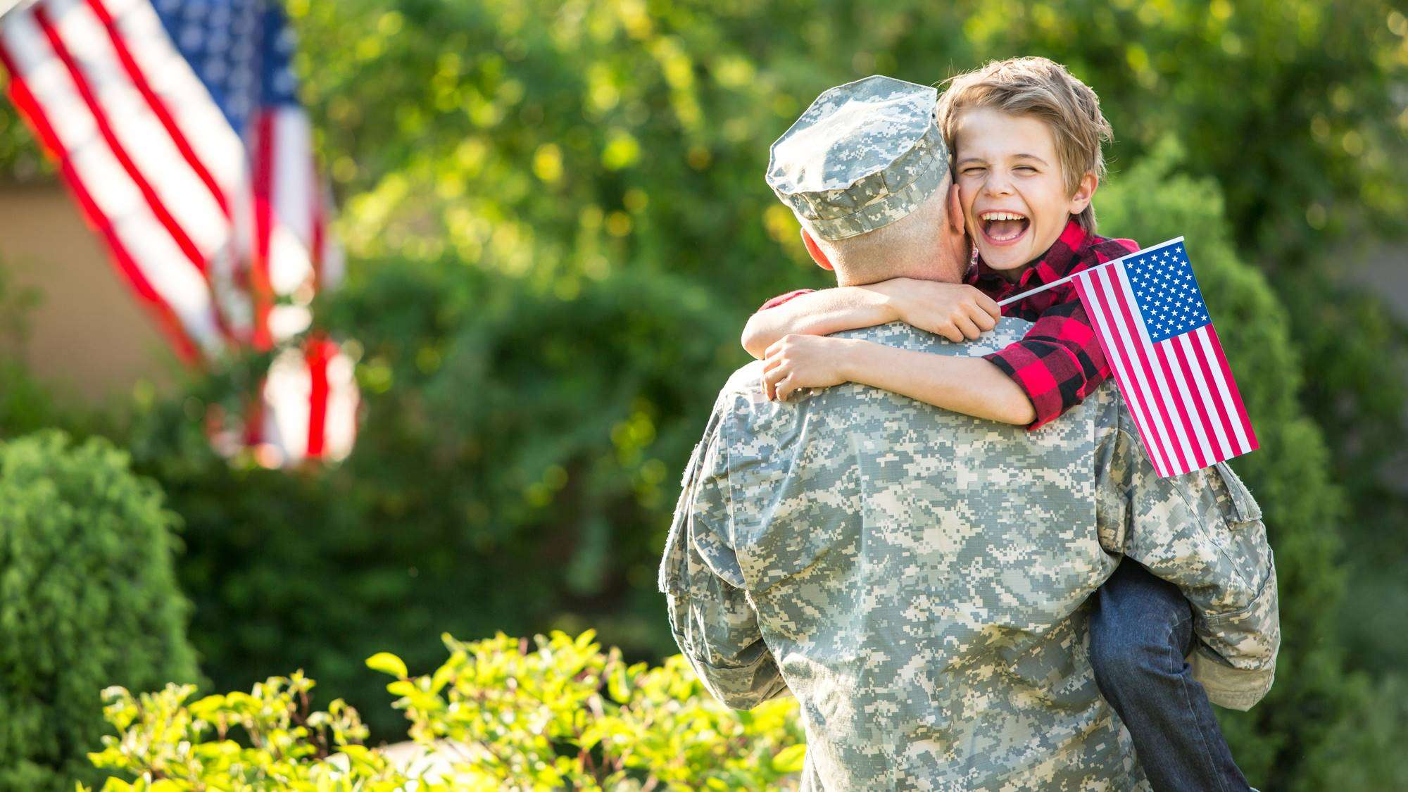 Veteran recovered from addiicton hugging son