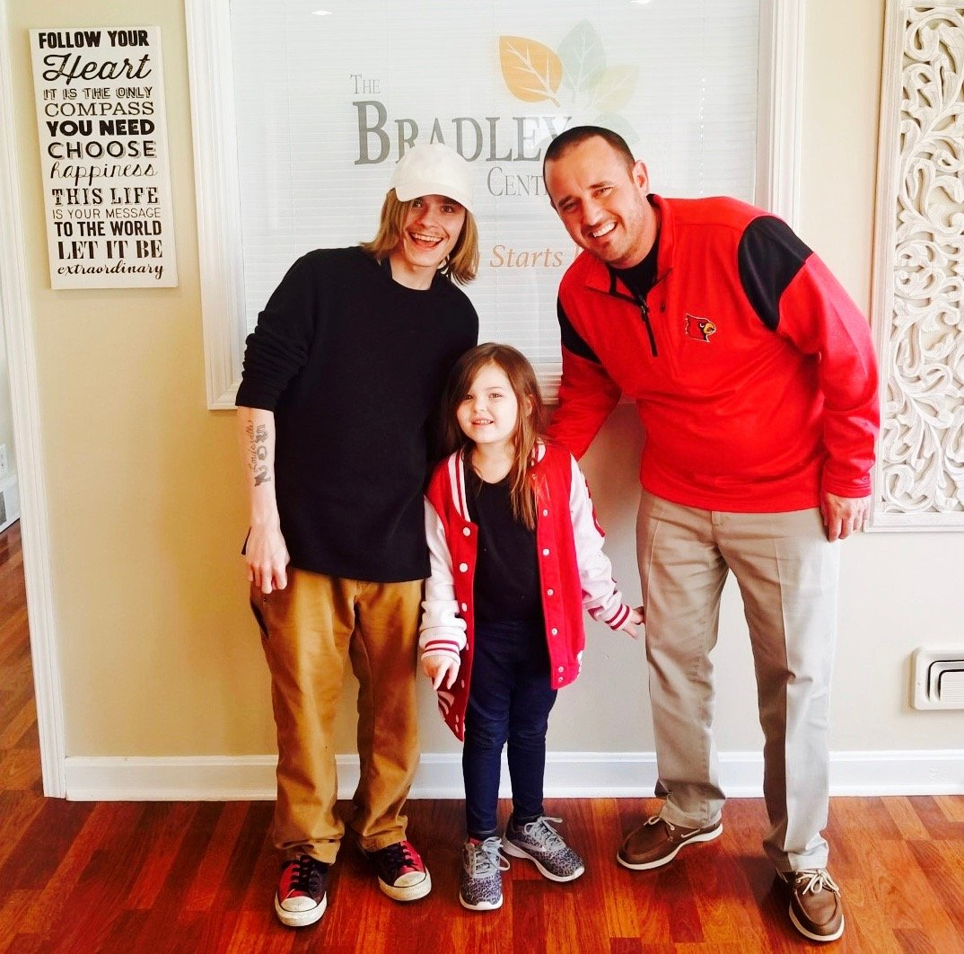 Jonathan Pike with his daughter and Bradley Helton